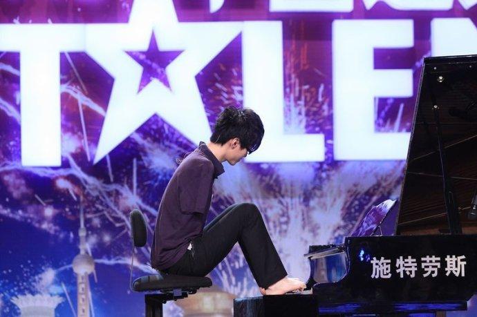 我眼中的断臂钢琴王子刘伟