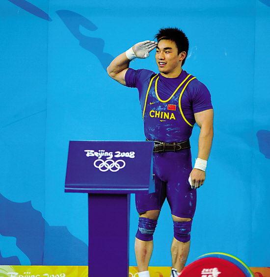 男子69公斤级举重双保险战术凑效 廖辉夺金敬礼